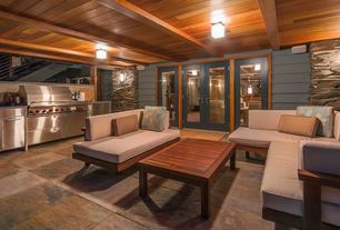 Craftsman Porch with Outdoor kitchen, French doors, exterior stone floors, Wrap around porch