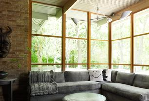 Contemporary Living Room with interior brick, Exposed beam, Ceiling fan, picture window, Carpet, High ceiling