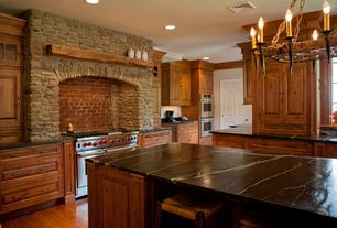 Country Kitchen with double wall oven, Inset cabinets, Interior stone wall, Kitchen island, partial backsplash, Galley