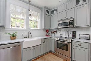 Country Kitchen with Pendant light, Farmhouse sink, gas range, Paint 1, Glass panel, Crown molding, double-hung window