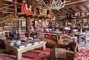 Rustic Great Room with Loft, Exposed beam, Chandelier, High ceiling, specialty door, Columns, Built-in bookshelf