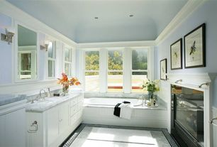 Traditional Master Bathroom with Flat panel cabinets, Wall sconce, can lights, double-hung window, European Cabinets, Flush