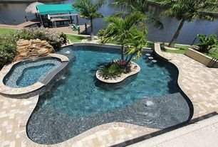 Tropical Swimming Pool with Pool with hot tub, Pool island, Pathway, Water feature, exterior brick floors, Solar heated pool