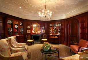 Traditional Living Room with Hardwood floors, Fireplace, Cement fireplace, Chandelier, High ceiling, specialty door