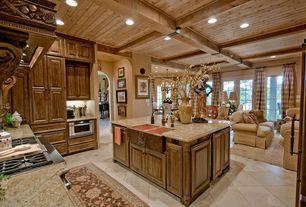 Country Kitchen with Exposed beam, Kitchen island, Arizona tile - torreon stone travertine, limestone tile floors, U-shaped