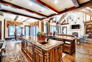 Craftsman Kitchen with metal fireplace, Chandelier, stone fireplace, Pendant light, Built-in bookshelf, French doors