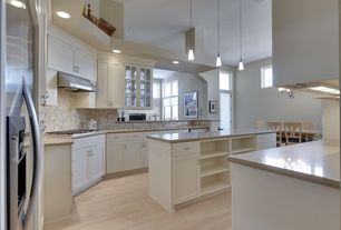 Traditional Kitchen with full backsplash, Built In Refrigerator, Stone Tile, Wall Hood, European Cabinets, High ceiling