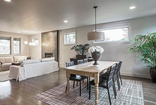 """Traditional Great Room with Lounge Slipcovered 93"""" Sofa, Conrad Grebel Farmhouse Dining Table, Standard height, Fireplace"""