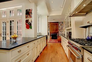 "Traditional Kitchen with Soapstone counters, Flush, Frameless, flush light, U-shaped, Wolf gr366x 36"" gas range, High ceiling"