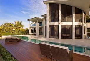 Modern Swimming Pool with exterior stone floors, Fence, Pathway