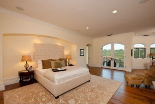 Contemporary Guest Bedroom with Crown molding, Hardwood floors, Arched window, French doors, High ceiling