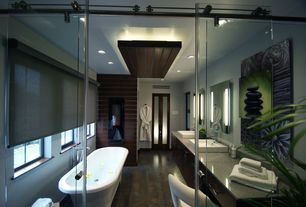 Contemporary Master Bathroom with Pental corten black silver 12x24, Freestanding, Simple granite counters, European Cabinets