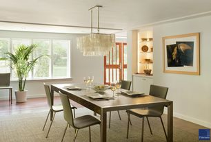 Modern Dining Room with Riedel Vinum XL Oaked Chardonnay 4 Piece Value Set, Hardwood floors, Large potted palm, Chandelier