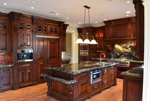 Traditional Kitchen with Ms international - titanium, U-shaped, Onyx counters, built-in microwave, Custom hood, Island sink