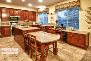 Traditional Kitchen with Simple granite counters, U-shaped, Raised panel, limestone tile floors, built-in microwave
