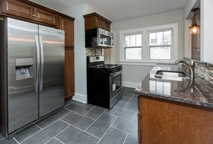 Modern Kitchen with Formica counters, Concrete tile , Pendant light, Subway Tile, Raised panel, Galley