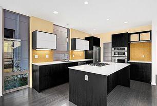 Contemporary Kitchen with Undermount sink, European Cabinets, L-shaped, Kitchen island, Ceramic Tile, Pendant light, Flush