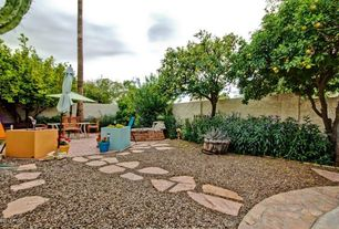 Mediterranean Landscape/Yard with Wildon Home Market Umbrella, exterior brick floors, Fence, Pathway, Raised beds