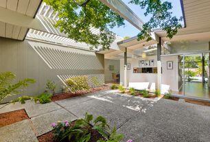Modern Exterior of Home with picture window, exterior concrete tile floors, Pathway, Trellis, sliding glass door