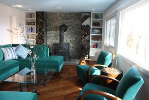 Eclectic Living Room with Fireplace, Hardwood floors, Wood Stove fireplace, can lights, Casement, picture window, Paint