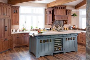 Country Kitchen with Flat panel cabinets, Kitchen island, Inset cabinets, European Cabinets, Large Ceramic Tile, Exposed beam