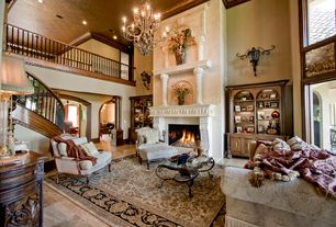 Mediterranean Living Room with Chandelier, Cement fireplace, High ceiling, Loft, Wall sconce, onyx tile floors, Crown molding