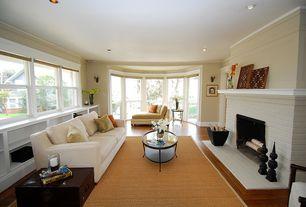 Craftsman Living Room with Hardwood floors, Magnussen Rachel Coffee Table, Wall sconce, Bay window, Built-in bookshelf