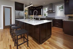 Contemporary Kitchen with Ceramic Tile, Undermount sink, French doors, Broan Chimney Stainless Steel Range Hood, Flush