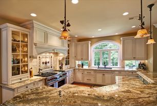 Traditional Kitchen with Limestone Tile, Arched window, Undermount sink, Complex granite counters, Stone Tile, Breakfast bar
