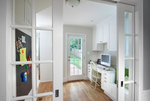 Traditional Home Office with Hardwood floors, flush light, French doors, Built-in bookshelf, can lights, Standard height
