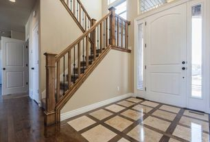 Country Entryway with Hardwood floors, Transom window, specialty door, High ceiling