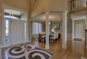 Traditional Entryway with High ceiling, six panel door, Columns, Laminate floors, Transom window, Paint 1, Balcony, Paint 2