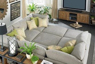 Contemporary Living Room with Dr. Pitt Slip Covered Sectional, Built-in bookshelf, Casement, interior brick, High ceiling
