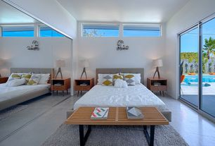 Modern Master Bedroom with sliding glass door, picture window, Concrete floors, Standard height