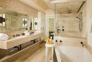 Contemporary Master Bathroom with Master bathroom, Undermount sink, Travertine counters, Glass panel door, Shower, can lights