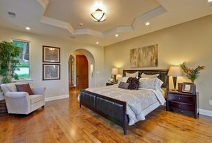 Traditional Master Bedroom with flush light, Hardwood floors