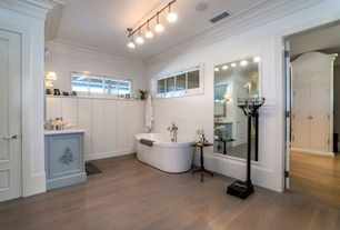 Cottage Full Bathroom with Wall sconce, flush light, Freestanding, specialty door, Crown molding, Wainscotting
