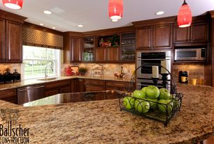 Traditional Kitchen with full backsplash, Limestone Tile, U-shaped, Simple granite counters, electric cooktop, Flush