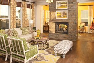 Eclectic Living Room with Ceiling fan, stone fireplace, Massoud Furniture Helen Spindle Chair, Hardwood floors