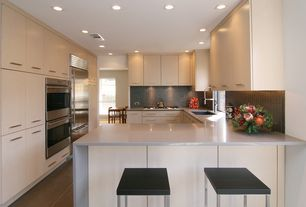 "Contemporary Kitchen with Carolina Cottage Hamilton 24"" Bar Stool, Waterfall countertop, U-shaped, Dupont Dove Corian, Flush"
