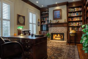 Traditional Home Office with Hightower polished brass desk lamp, Hardwood floors, Standard height, brick fireplace, Fireplace