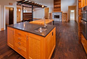 Rustic Great Room with Pendant light, specialty door, Columns, stone fireplace, Hardwood floors, High ceiling