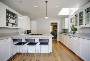 Modern Kitchen with Hardwood floors, Breakfast bar, Glass panel, Flush, Limestone, Pental quartz cotton white, Skylight