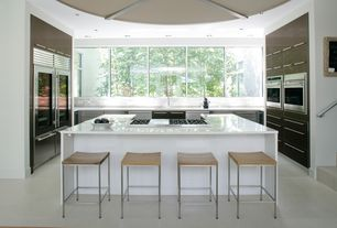 Contemporary Kitchen with U-shaped, Corian counters, Breakfast bar, European Cabinets, two dishwashers, Stanley bar stool