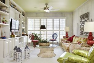Tropical Living Room with Ceiling fan, Crown molding, interior wallpaper, Carpet, Built-in bookshelf
