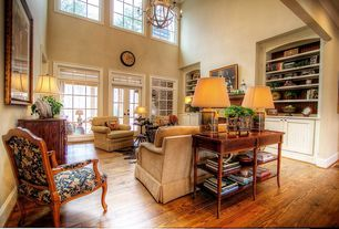Country Living Room with Hardwood floors, High ceiling, Chandelier, Built-in bookshelf, French doors