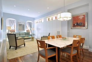 Contemporary Dining Room with Chandelier, Hardwood floors