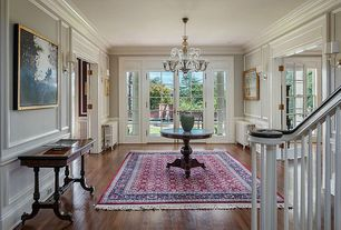 Traditional Entryway with Chandelier, Crown molding, Standard height, Wainscotting, Hardwood floors, Chair rail, French doors