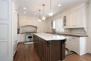 Traditional Kitchen with Inset cabinets, Pendant light, Undermount sink, Soapstone counters, Crown molding, U-shaped