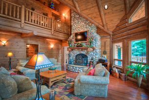 Rustic Great Room with Standard height, Fireplace, Hardwood floors, Balcony, Wall sconce, stone fireplace, can lights